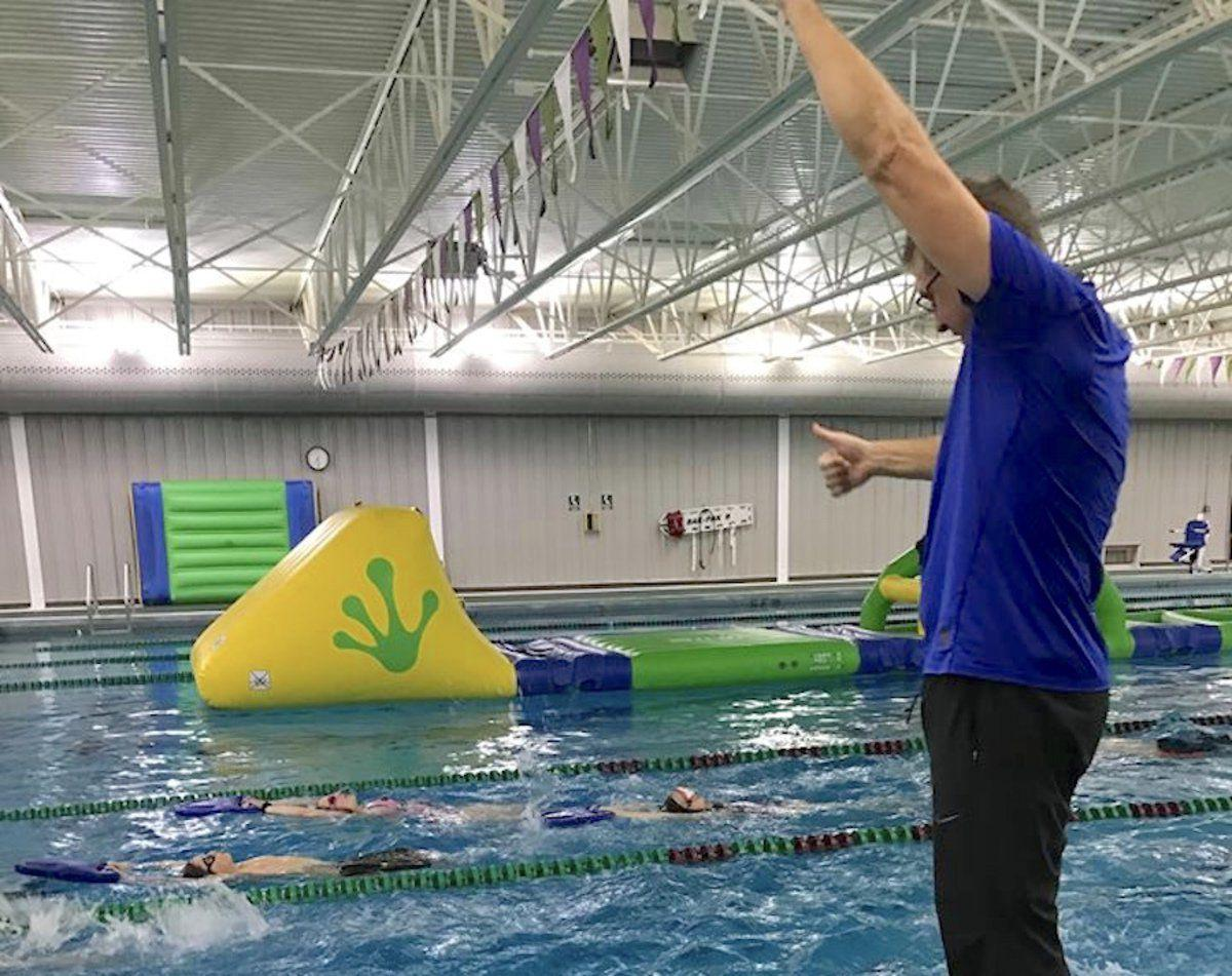 Local swim team competes at statewide level sports - Northeastern university swimming pool ...