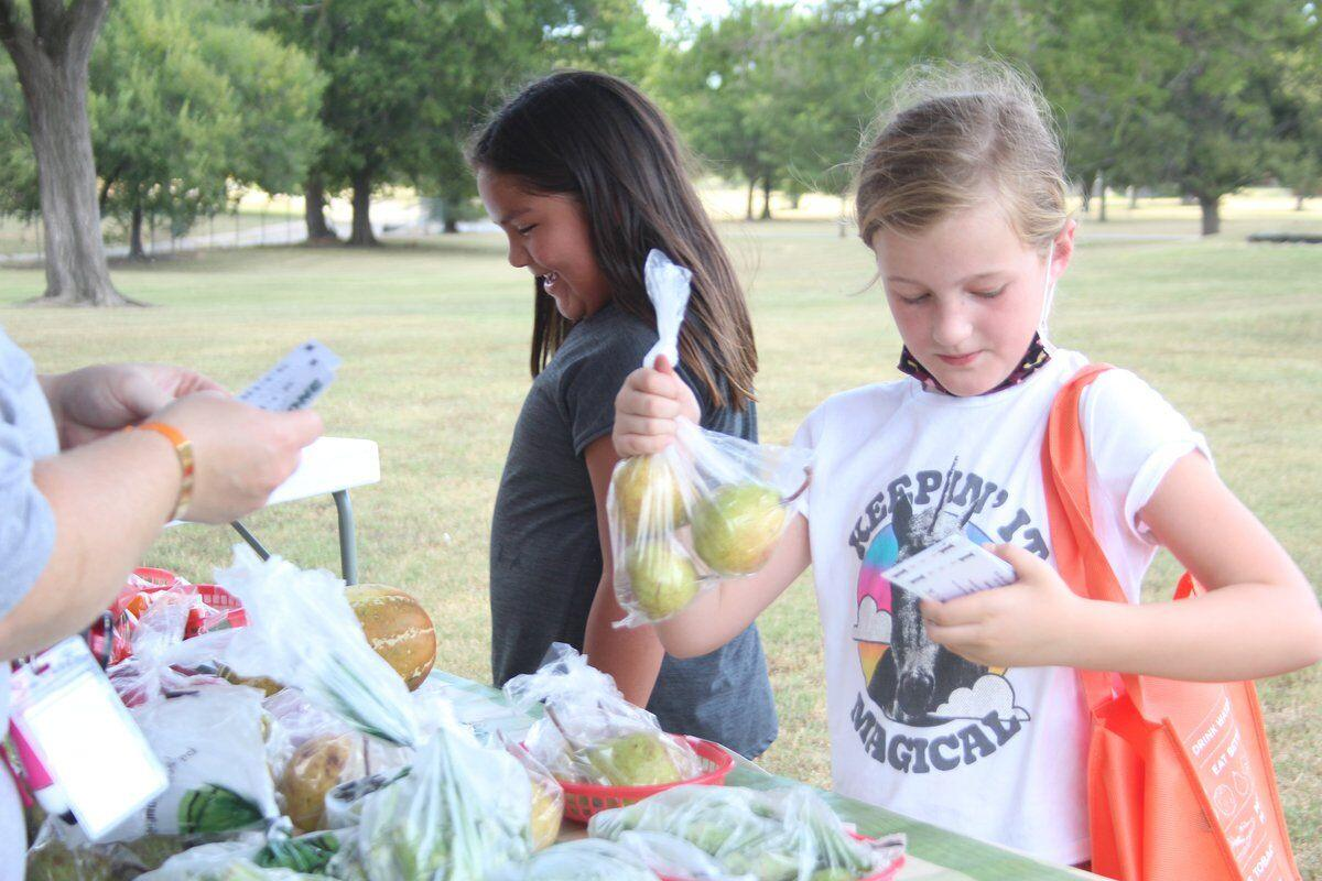 FARM FRESH FOOD: Tahlequah Farmers Market distributes 'veggie bucks' to coax third-graders into eating right