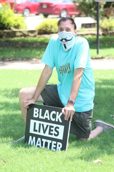 Still kneeling: Local resident continues to protest police brutality