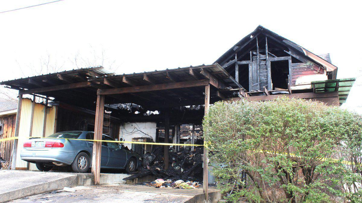Condition of woman who lived in burned house unconfirmed