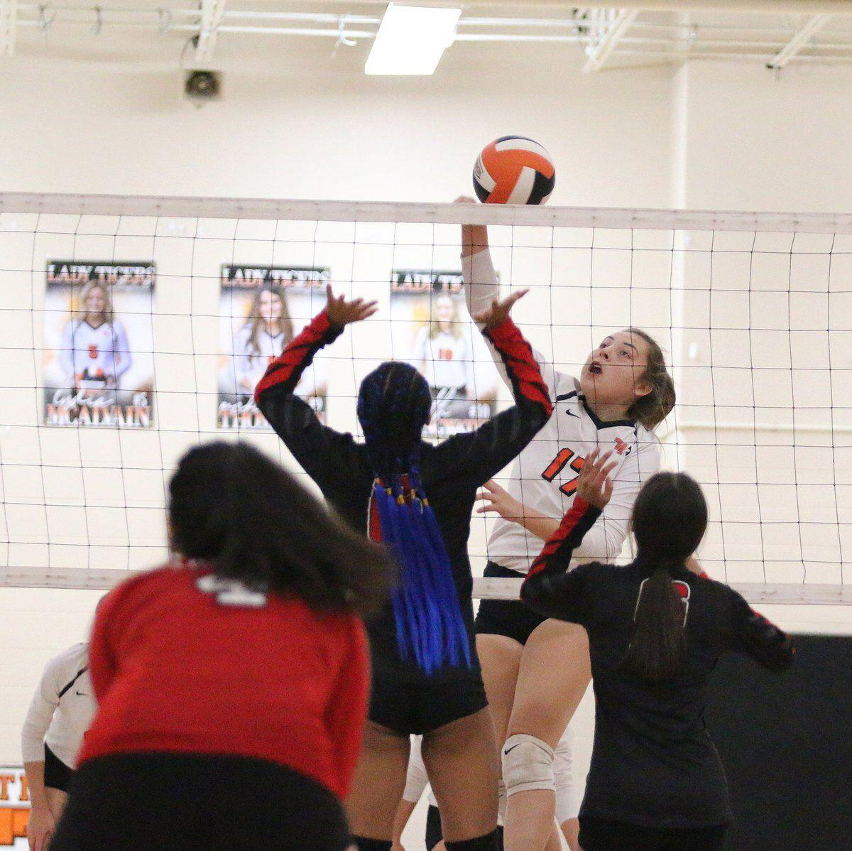 TAHLEQUAH BREEZES: Lady Tigers sweep Tulsa East Central in three sets