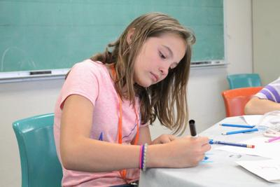 Students tie jewelry creations into science