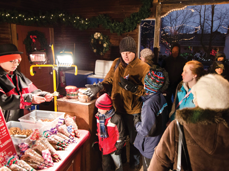 To warm up, and fill up, visitors can buy food like roasted nuts and kettle corn at one of the many shops in Crossroads Village.
