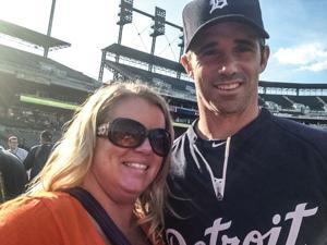 Courtney Gregory of Fenton poses with Detroit Tigers Manager Brad Ausmus at a game last summer.