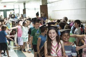 West Shore Elementary School graduated 140 second-graders on Tuesday, June 13, with a school-wide clap-out. In front are Delilah Cherry and Gabrielle DeMasi (right).