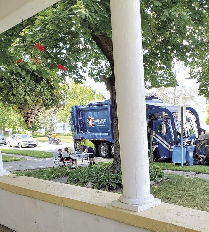 Lyric and Leander sell lemonade to garbage truck driver.jpeg