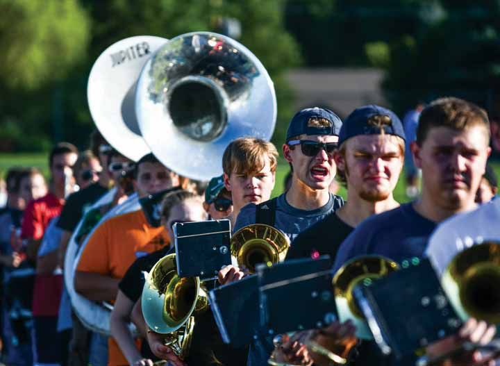 Lake Fenton High School Marching Band rehearses in August for its fall football season. The band headed to Chicago this weekend to perform in the nation's largest evening parade.