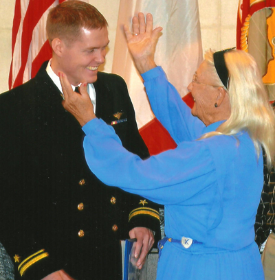 Betty Richter Siersma prepares to hug her grandson, Richard A. Siersma after pinning his newly earned Naval Aviator Wings to his lapel.