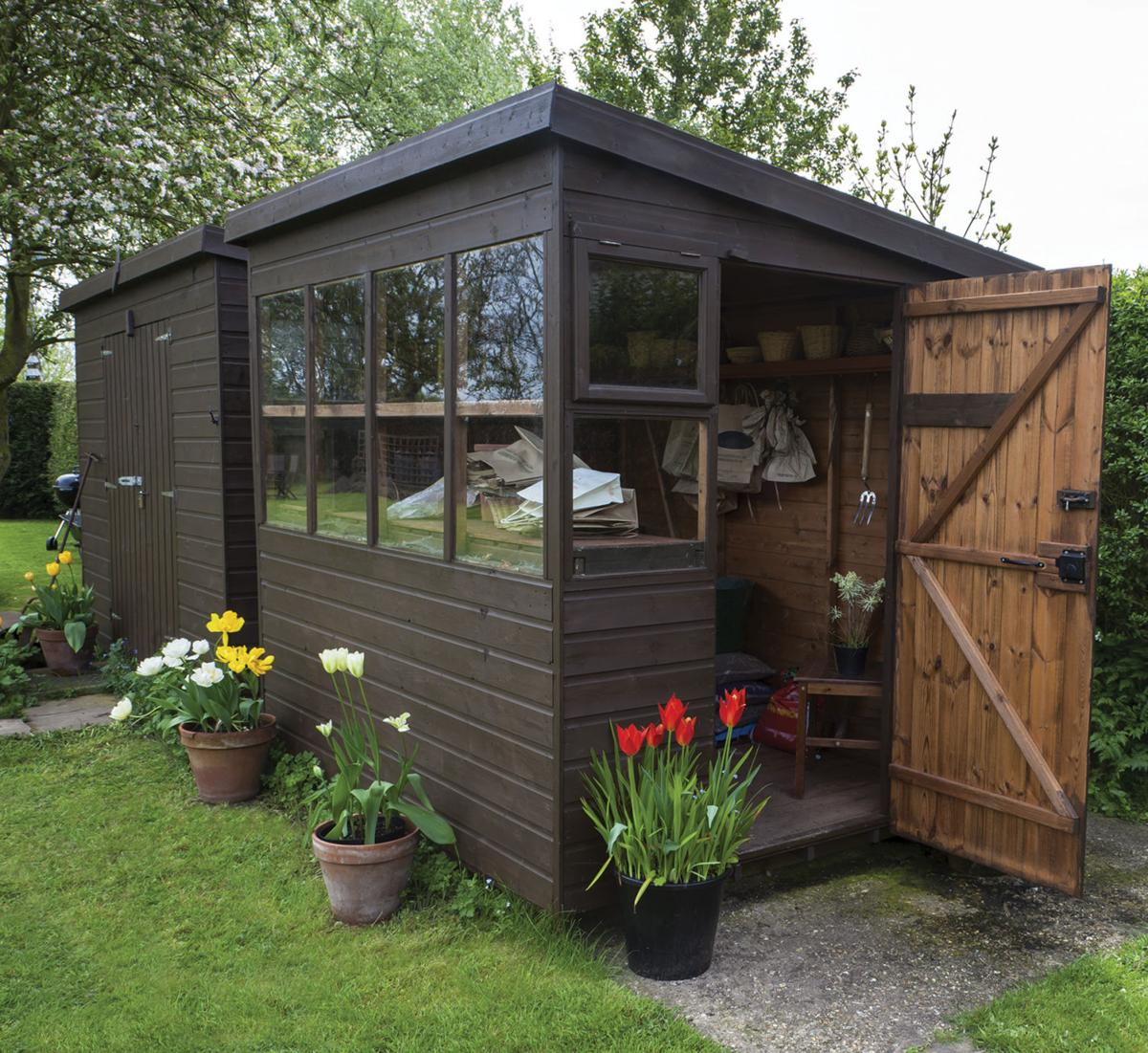 He shed, she shed... | Featured Sections | tctimes.com on greenhouse designs, house barn combo plans, garden shed greenhouse plans, greenhouse made out of old windows, potting shed greenhouse plans, backyard greenhouse shed plans, shed with greenhouse plans,
