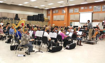 The Fenton Community Orchestra rehearses for an upcoming concert. The next concert is Friday, Dec. 11 at 7:30 p.m. in Fenton High School Ruby Zima Auditorium.