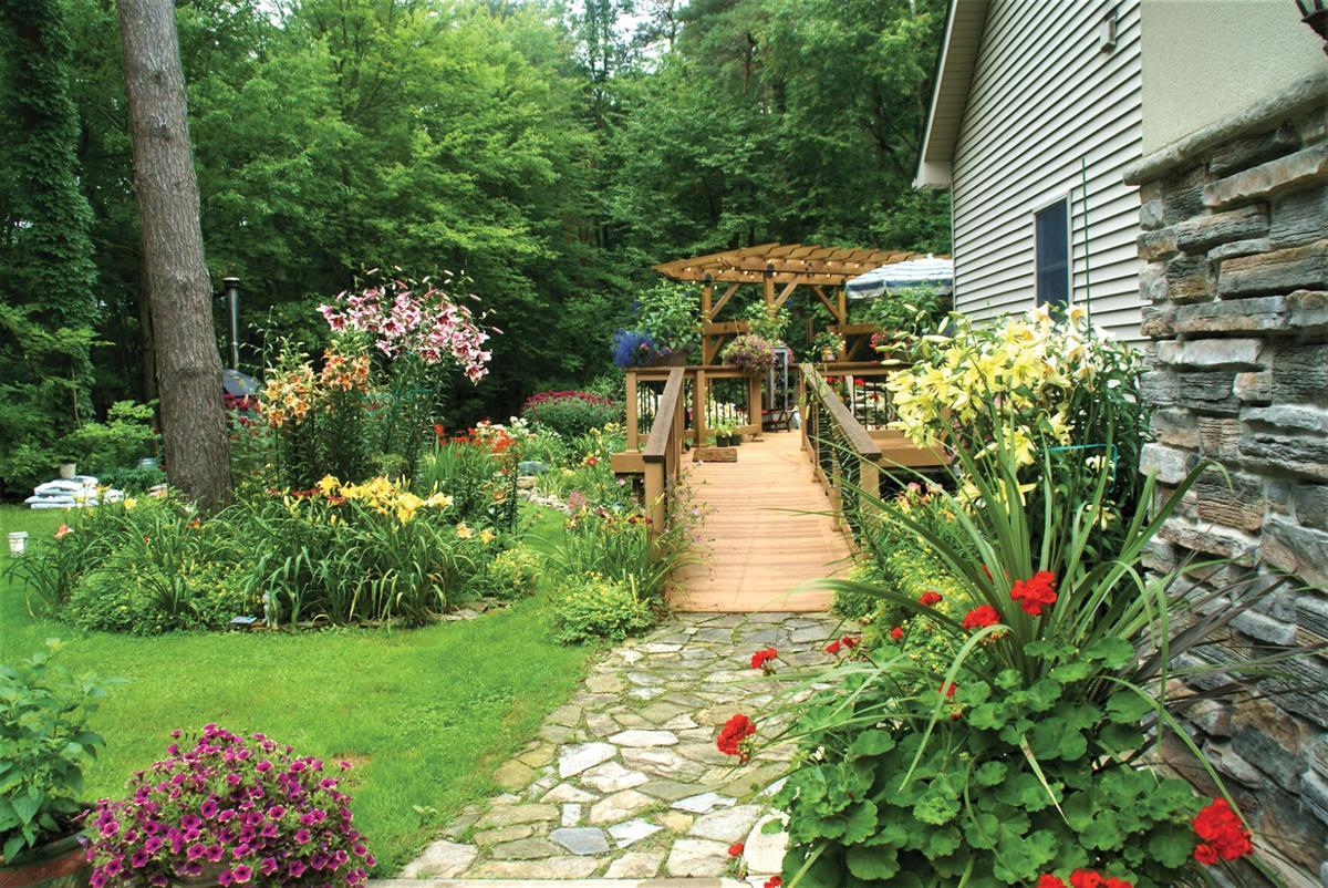 open gate garden club stop at Jim Pabst Garden.JPG