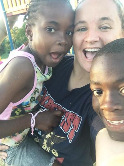 During a three-week study abroad to Jamaica Linden graduate Savannah Weaver came up with the idea to help provide baseball and softball equipment to the Jamaica Little League organization by having people donate their used equipment. Weaver is pictured here with some of the children that influenced her life during the trip.