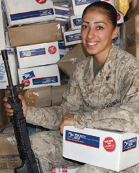 Food, CDs and a special note from the sender are included with the car packages for the troops.