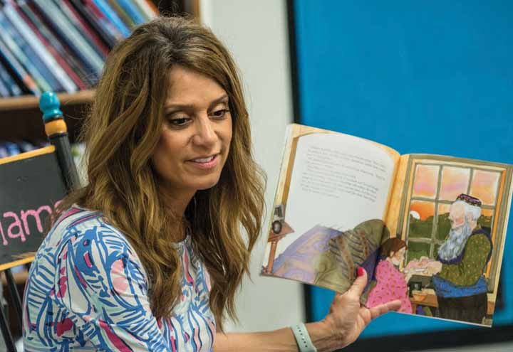 """Torrey Hill Intermediate School fourth-grade teacher Jennifer Williams reads """"The Bee Tree"""" to her students on Thursday morning. Williams, 46, was a teacher at the time of the terrorist attacks on Sept. 11, 2001."""