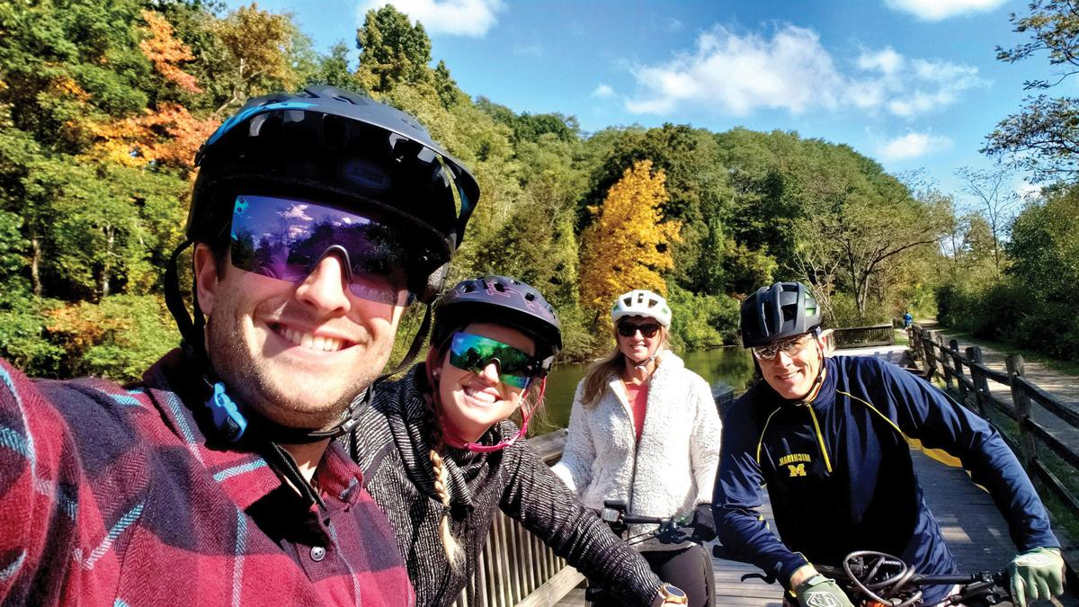 ed and julie furmanczyk with kids up north on bikes.jpg