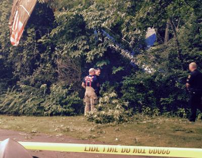 Fenton Township firefighters and Genesee County Sheriff's deputies assess damage from a plane crash Saturday evening. The pilot was able to walk away.