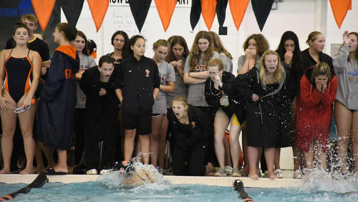 The Fenton girls swim team cheers on one of their relay squads.