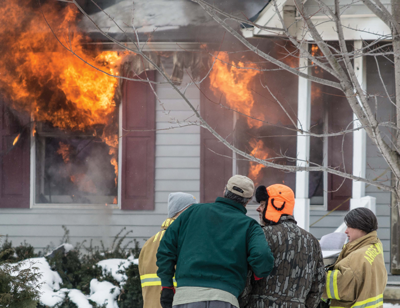 The fire that destroyed this home in Argentine Township on February 9 was caused by a wood burning stove in the basement.