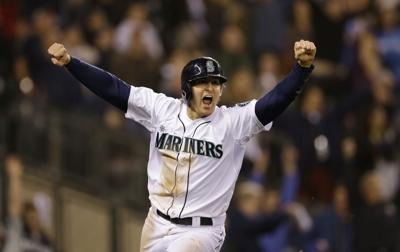 Mariners still in playoff race, beat Angels in 11