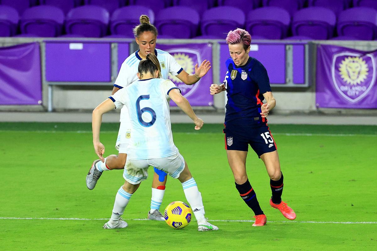 The United States' Megan Rapinoe passes against Argentina in the SheBelieves Cup at Exploria Stadium in Orlando, Florida, on Wednesday, Feb. 24, 2021.