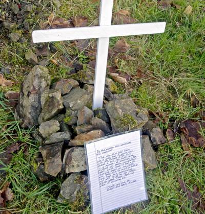 Roadside memorial vandalized