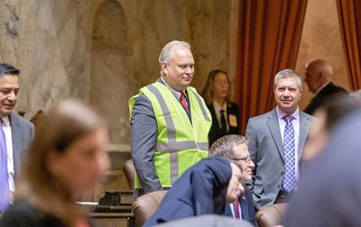 Walsh dons yellow vest
