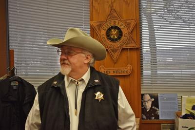 7e3d16ce7056b Cowlitz County Sheriff Mark Nelson takes one of his last looks around his  office Wednesday