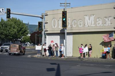 Demonstrators by old Office Max building