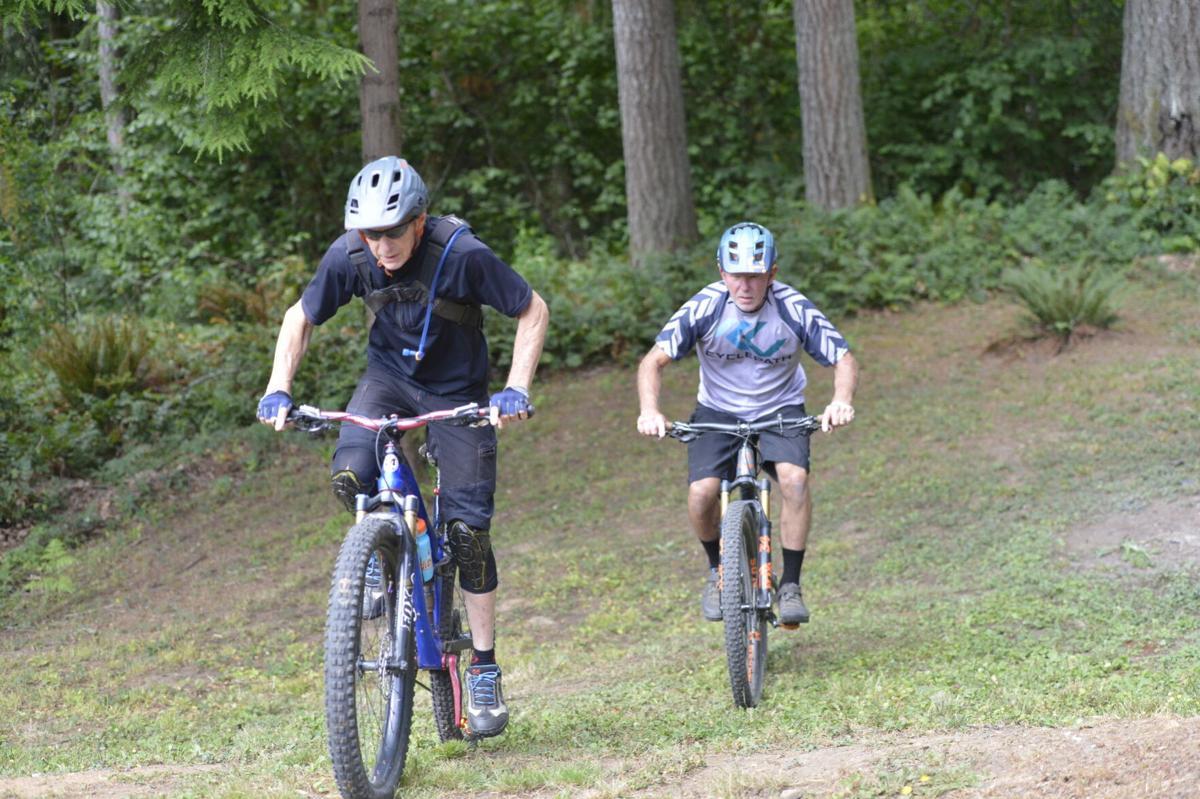 LeMonds and Horness riding forward