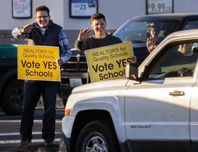 School bond sign waving