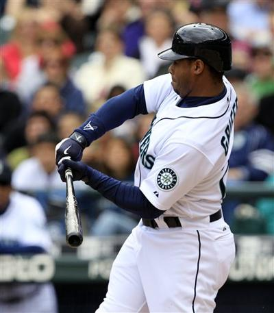 1253b1ace0 Ken Griffey Jr. checks his swing during a game against the San Diego Padres  on May 23 in Seattle. Elaine Thompson / AP