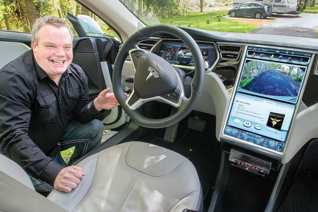 Talking Business: Longview's EcoCab adds futuristic Tesla to its