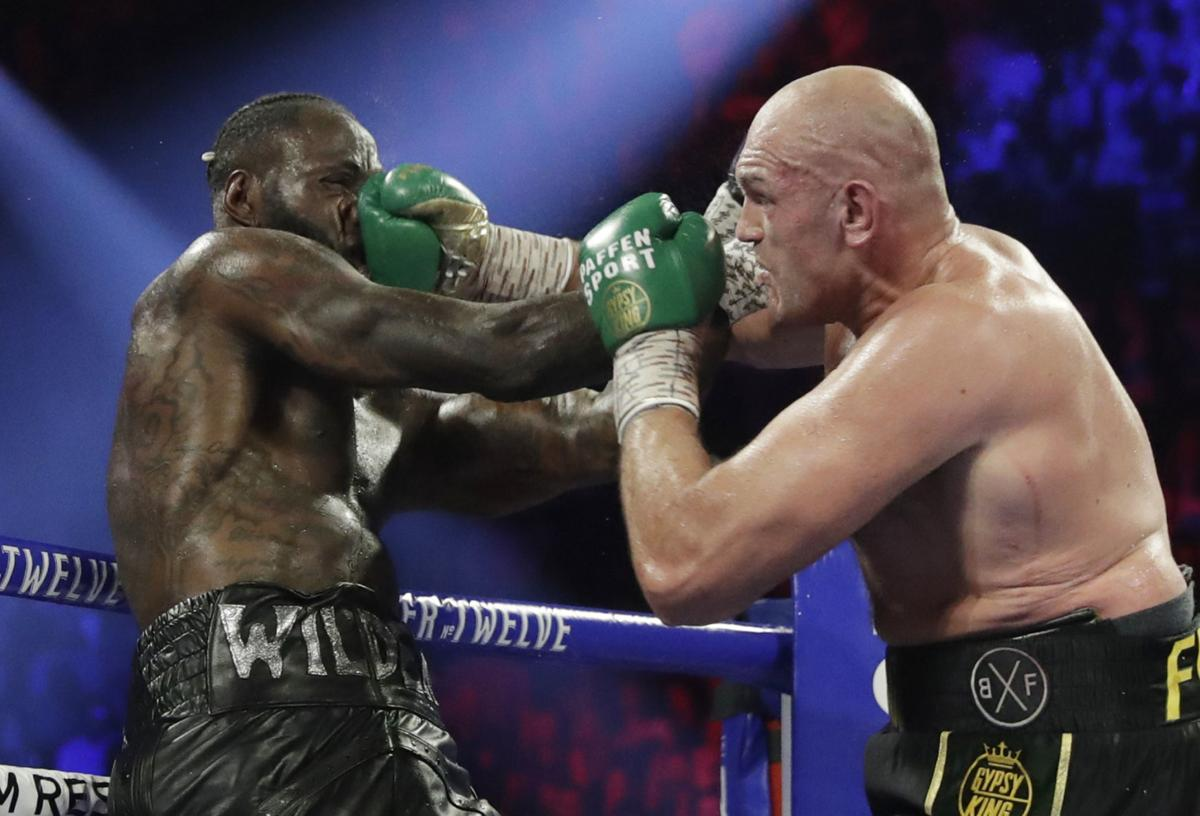APTOPIX Fury Wilder Boxing