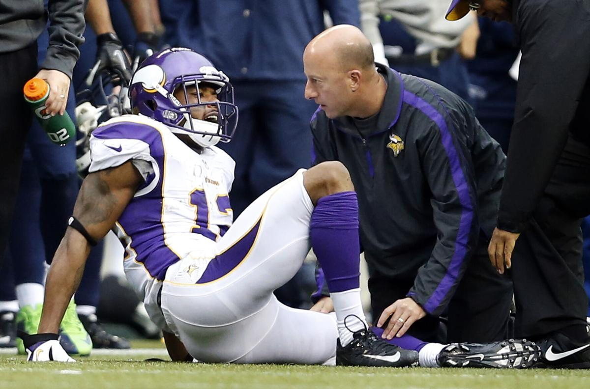 Head athletic trainer Eric Sugarman attends to Minnesota Vikings receiver Percy Harvin (12) in the third quarter. The Seattle Seahawks beat the Minnesota Vikings, 30-20, at CenturyLink Field in Seattle, Washington on Sunday, November 4, 2012.