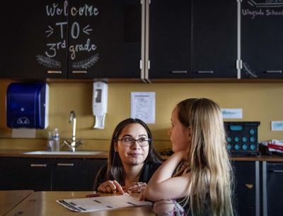 Lili Venegas helps a student