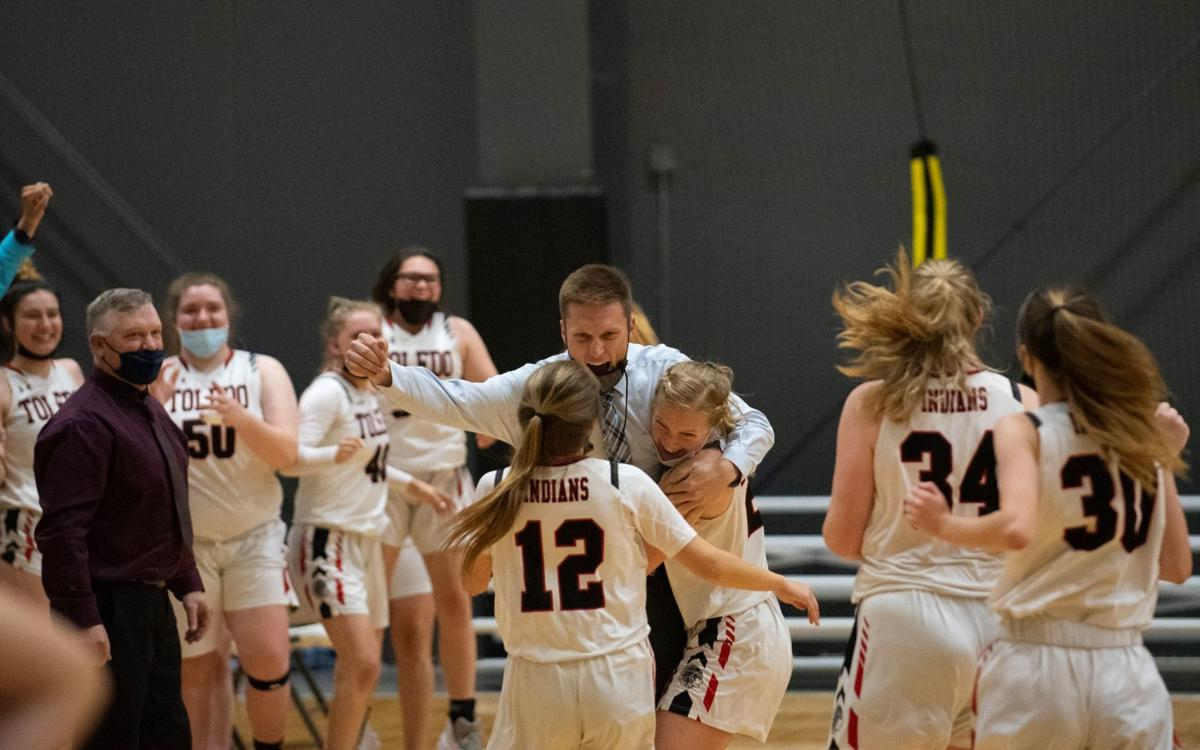 Toledo girls basketball celebrate