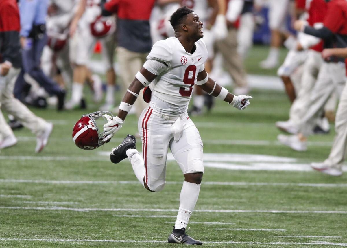Alabama quarterback Bryce Young celebrates a win against Florida during the SEC Championship game at Mercedes-Benz Stadium in Atlanta on December 19, 2020.