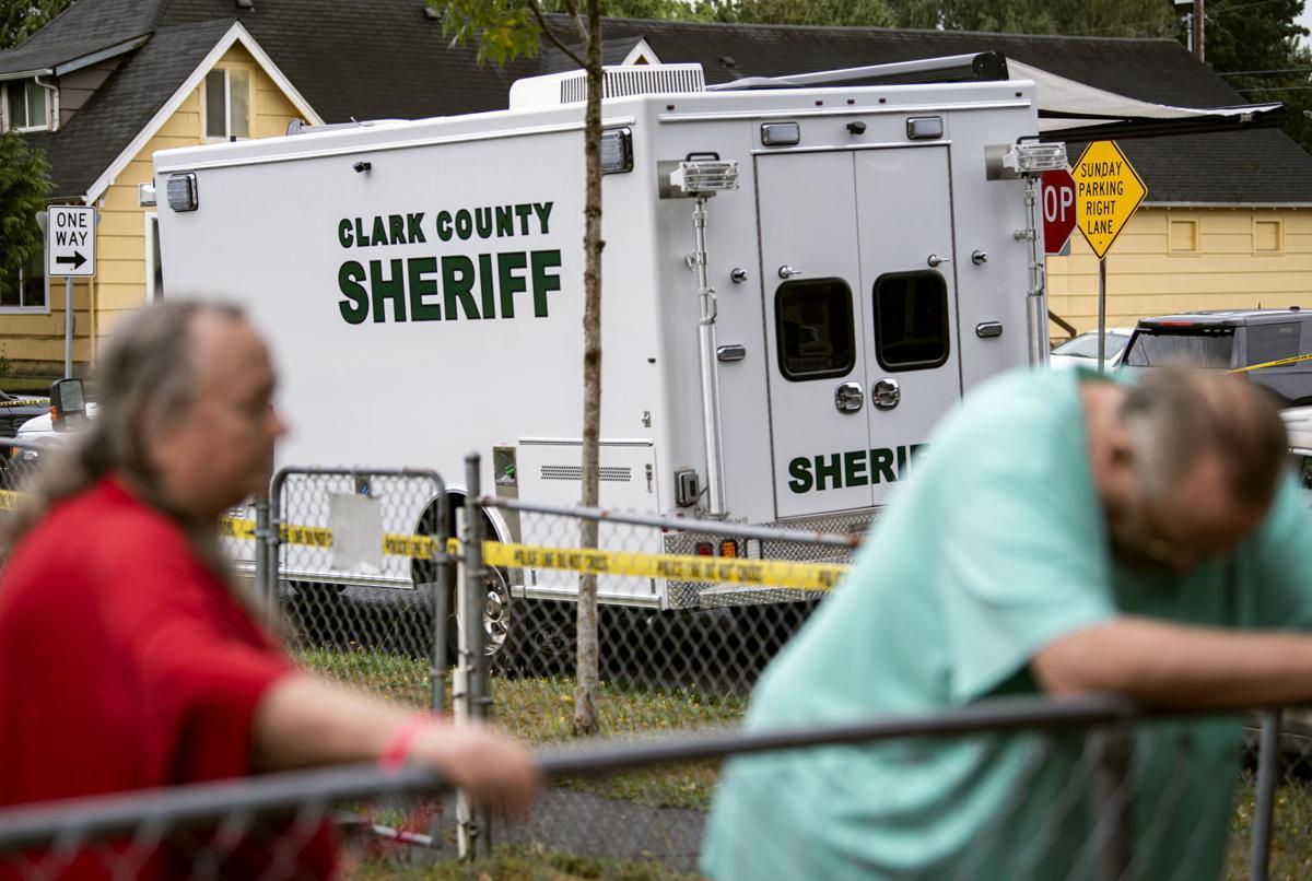 Neighbors watch the crime scene