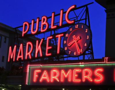 Pike Place Market is the hub of Seattle, where fresh, local produce, seafood, specialty foods and crafts are bought and sold, on Aug. 24, 2014. Open since 1907, the market is a bustling place where live music provides the backdrop to the hundreds of shops and thousands of visitors each day.