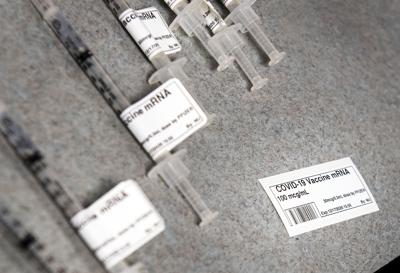 COVID-19 vaccine syringes