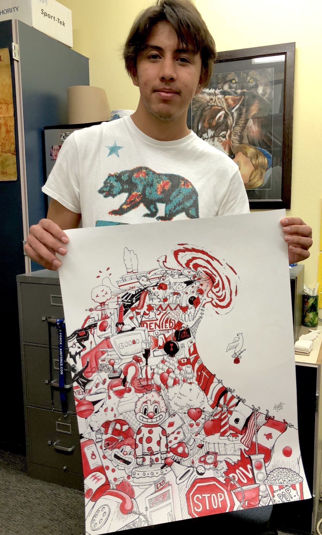 Luis Gurrola with his art