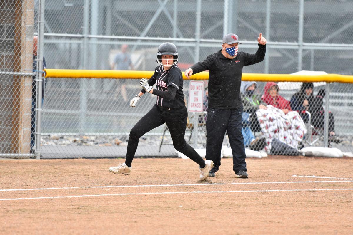 Jaydn Terry runs for R.A. Long softball
