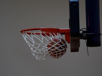 Basketball stock ball in net