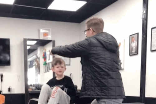 This Barber Has A Clever Way Of Giving A Haircut To A Boy With