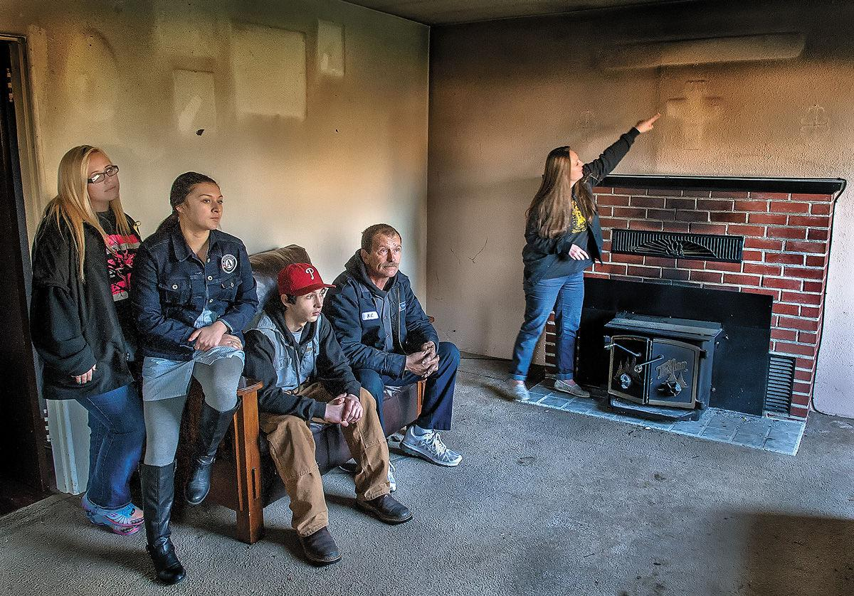 Tables turn on hearts for homeless family after fire damages lynn brown points at the singed wall where her wedding photo once hung in a cross shaped frame an electrical fire destroyed the familys longview home on jeuxipadfo Images