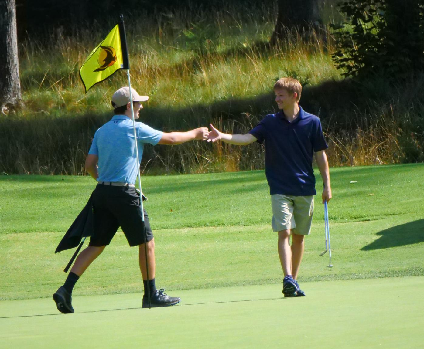 Young golfers link up at Village camp