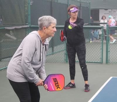 Village pickleball players hit court