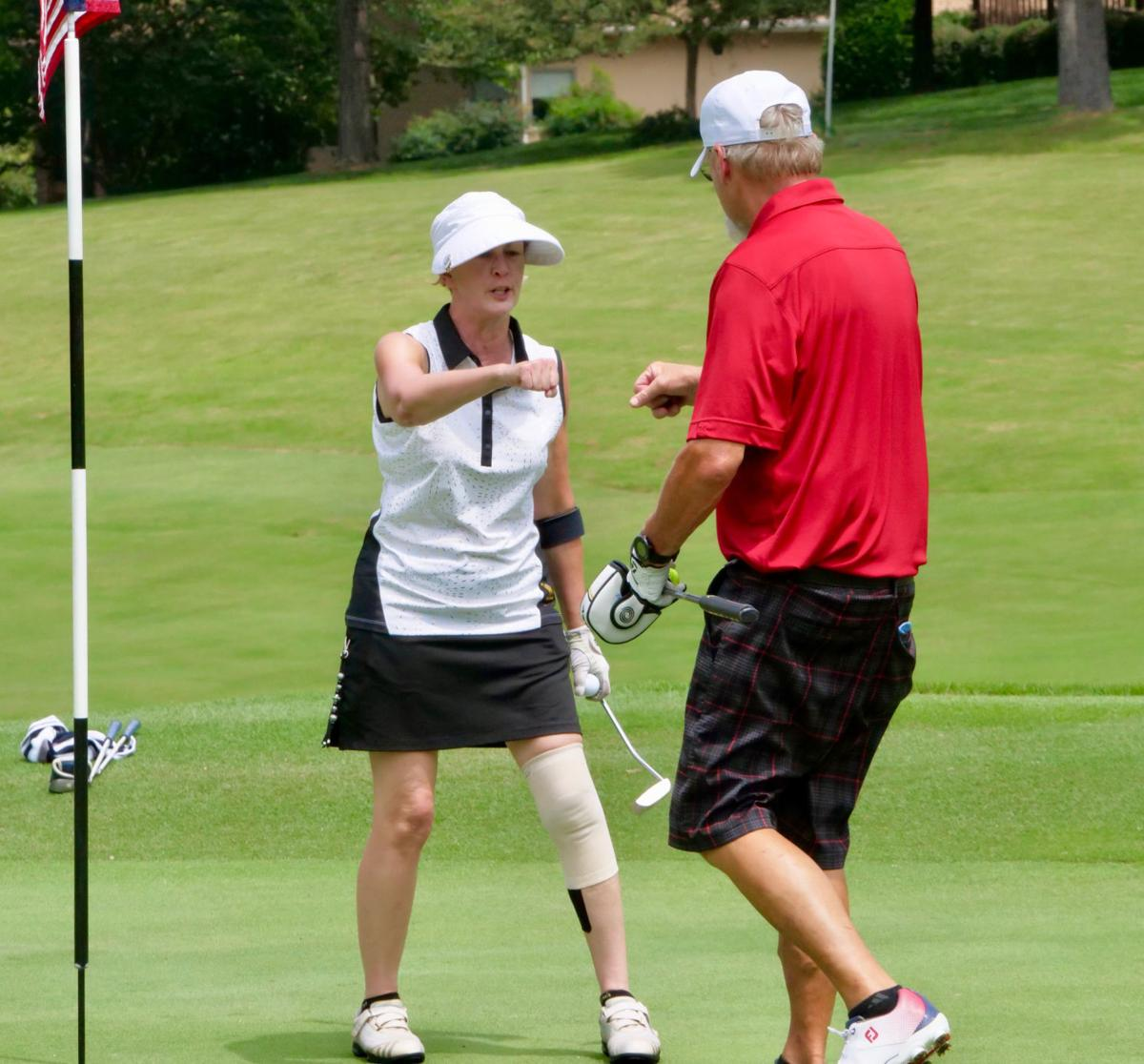 Golfers tee off for veterans