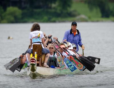 Villagers race through the water