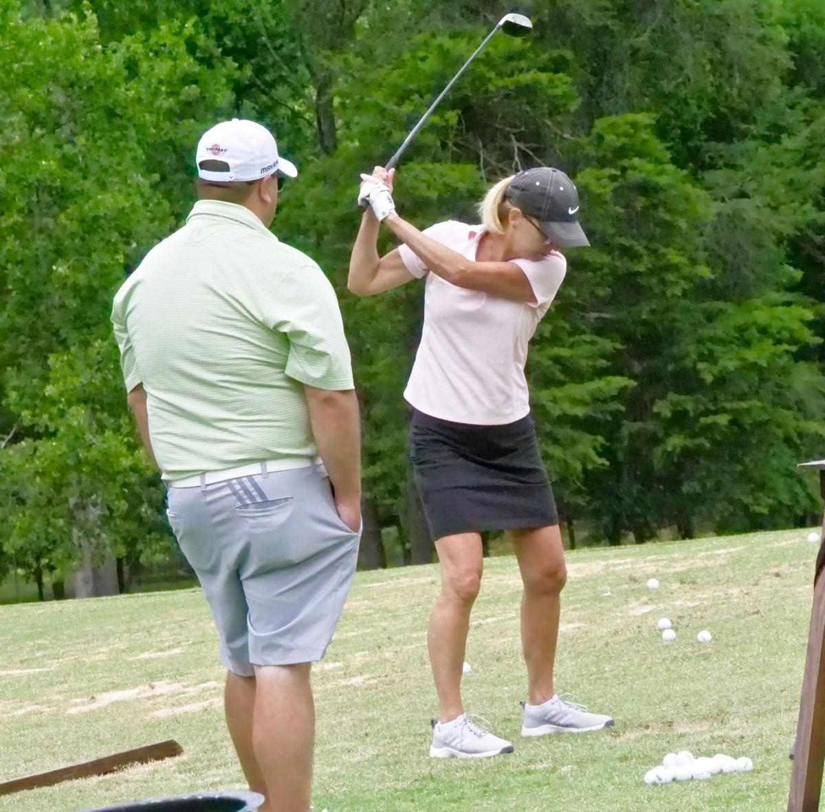 Village golfers link up on the greens